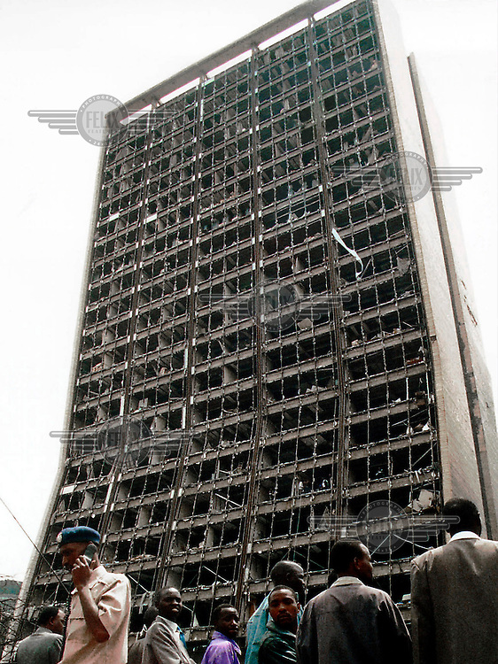 A terrorist bomb aimed at the American Embassy caused devastation, reducing the embassy and a neighbouring five-storey office block to mounds of rubble. Over two hundred people were killed and thousands injured. The blast, and a simultaneous attack on the US Embassy in Tanzania, were blamed on al-Qaeda, and four men linked to the group were convicted for their part in the bombings..All the windows of another building were smashed by the explosion.