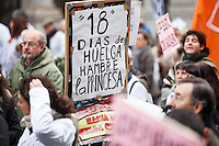 During the fist Spanish protest of 2013  somebody is holding  a placard for Juan Recio on hunger strike 18 days