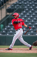 AZL Angels first baseman Bernabe Camargo (64) follows through on his swing during the completion of a suspended Arizona League game against the AZL Diamondbacks at Tempe Diablo Stadium on July 16, 2018 in Tempe, Arizona. The game was a continuation of the July 11, 2018 contest that was suspended by rain in the middle of the eighth inning. The AZL Diamondbacks defeated the AZL Angels 12-8. (Zachary Lucy/Four Seam Images)
