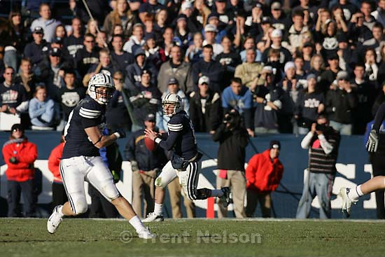 sequence of Brigham Young quarterback Max Hall (15) hits Brigham Young wide receiver Austin Collie (9) on famous 4th and 18 play that leads to a winning touchdown by Brigham Young runningback Harvey Unga (45) .  Provo - BYU defeats the University of Utah 17-10 in college football action Saturday at BYU's Lavell Edward Stadium.
