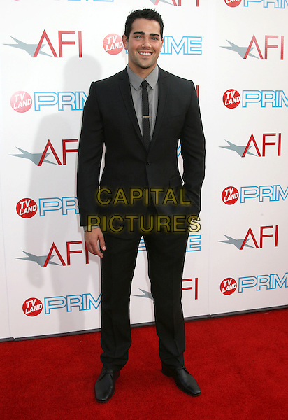 JESSE METCALFE.37th AFI Life Achievement Awards, Sony Pictures Studios,  Culver City, California, USA..June 11th, 2009.full length shirt black suit hand in pocket grey gray .CAP/ADM/MJ.©Michael Jade/AdMedia/Capital Pictures.