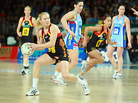 28.06.2010 Magic's Laura Langman in action during the ANZ Champs Semi Final netball match between the Magic and Steel played at Vector Arena in Auckland. ©MBPHOTO/Michael Bradley