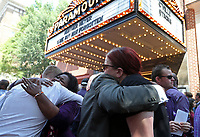 People hug outside the Paramount Theater after a memorial for Heather Heyer Wed., August 16, 2017, in Charlottesville, Va. Heyer was killed the previous weekend when a vehicle drove into a crowd of counter-protestors after the Unite The Right rally. Photo/Andrew Shurtleff