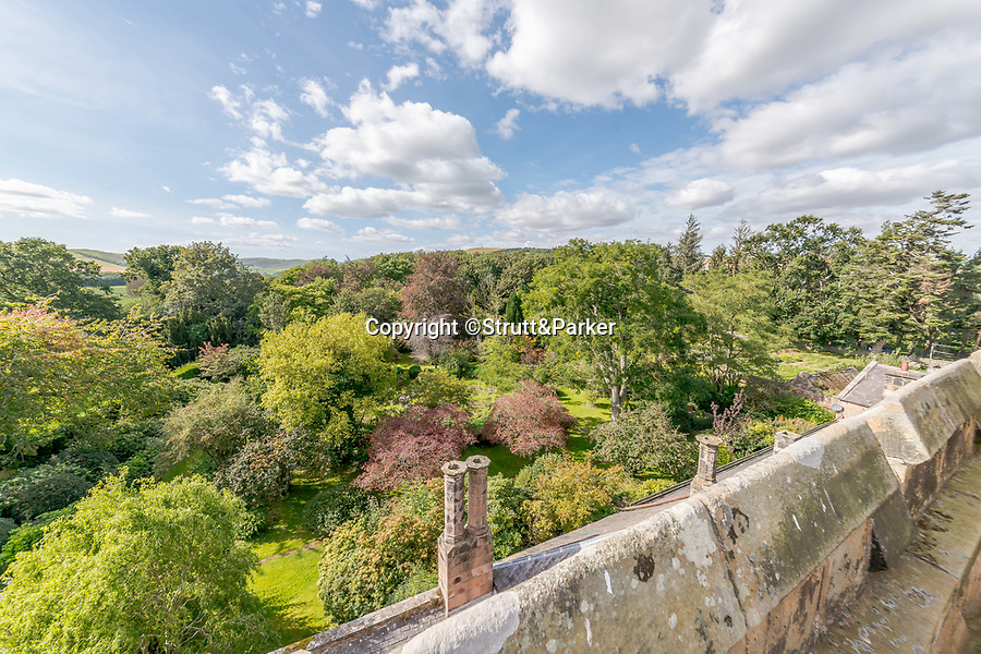 BNPS.co.uk (01202 558833)<br /> Pic: Strutt&Parker/BNPS<br /> <br /> A fantastic view from the castle<br /> <br /> A stunning castle that once belonged to. swashbuckling sailor who killed the real-life Jack Sparrow has gone on the market for offers over £1.9m.<br /> <br /> Coupland Castle in Northumberland is Grade I listed and is steeped in history dating back to the 12th century.<br /> <br /> It's Pele Tower was the last fortified building to be constructed in the Border area and before that the land on which it was built belonged to Sir John de Coupland, who captured the Scottish King at the Battle of Neville's Cross in 1346.<br /> <br /> During the 18th century a separate farmhouse was added to the south-west of the now L-shaped tower and it was sold in 1713 to Sir Chaloner Ogle.