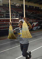 NWA Democrat-Gazette/ANDY SHUPE<br /> Arkansas' women's track and field athlete Kiara Parker celebrates with brooms Saturday, May 11, 2019, after winning the SEC Outdoor Track and Field Championship at John McDonnell Field in Fayetteville. Visit nwadg.com/photos to see more photographs from the meet.