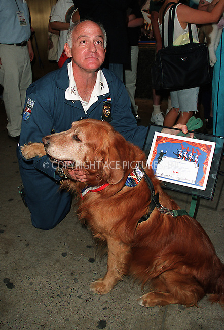 """Capt. Scott Shields (Emergency Management Director for Marine Safety Service) pictured with his pooch Bear. ....Bear, who is 12-year-old golden retriever, is one of the top Ground Zero search-and-rescue dogs and The Guinness Book of Records' """"the most celebrated dog in the world."""" Bear worked tirelessly for months at the World Trade Center site suffering cuts, bruises and smoke inhalation, which led to his worsened health conditon. Bear has been treated for skin cancer, prostatitis, nerve damage, arthritis, which resulted in $3000 in veterinary bills. Although, Bear and all other WTC search-and-rescue dogs, have had free policies from Veterinary Pet Insurance of Anaheim, Calif., the insurer refuses to cover the dog's medical bills insisting that Bear does not meet the requirements. The insurer insists that it had the perfect right to deny coverage, saying Bear's woes were """"pre-existing conditions"""" and """"old age disabilities."""" Scott Shields, however, says that Bear had never been sick a day in his life until the 9/11 tragedy. July 2002. Please byline: Alecsey Boldeskul/NY Photo Press.   ..*PAY-PER-USE*      ....NY Photo Press:  ..phone (646) 267-6913;   ..e-mail: info@nyphotopress.com"""