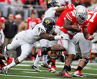 Ohio State Buckeyes running back Warren Ball (28) is chased by Kent State Golden Flashes linebacker Marques Moore (45) during Saturday's NCAA Division I football game at Ohio Stadium in Columbus on September 13, 2014. Ohio State won the game 66-0. (Dispatch Photo by Barbara J. Perenic)