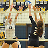 Massapequa No. 13 Mackenzie Byrne, left, defends against a spike attempt by Plainview JFK No. 2 Joanna Savino during a Nassau County varsity girls' volleyball game at Massapequa High School on Wednesday, September 9, 2015. Massapequa rallied from a 19-10 deficit in the first set to win 25-21, 25-14, 25-16.<br /> <br /> James Escher