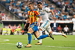 Real Madrid's Carlos Henrique Casemiro and Valencia's Rodrigo Moreno during La Liga match between Real Madrid and Valencia CF at Santiago Bernabeu Stadium in Madrid, Spain August 27, 2017. (ALTERPHOTOS/Borja B.Hojas)