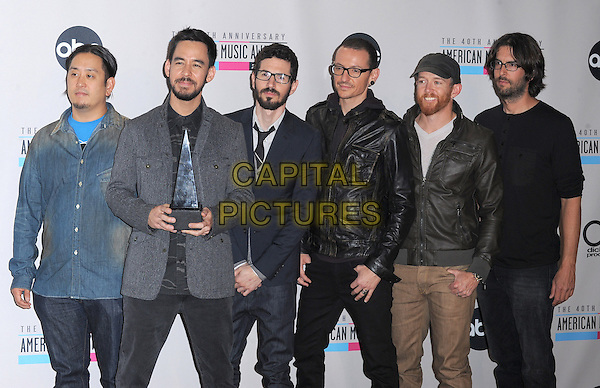 Linkin Park.40th Anniversary American Music Awards - Press Room held at Nokia Theatre L.A. Live, Los Angeles, California, USA..November 18th, 2012.AMA AMAs half length blue grey gray black leather jacket top beard facial hair trophy winner  band group Chester Bennington, Rob Bourdon, Brad Delson, Dave Farrell, Joe Hahn, Mike Shinoda                                         .CAP/DVS.©DVS/Capital Pictures.