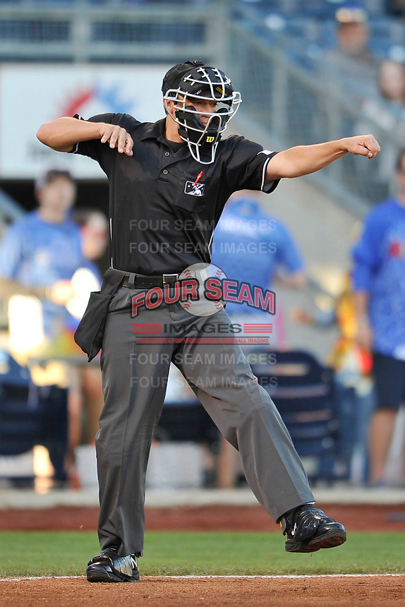 Home plate umpire Tyler Olson in action in a game between the Tulsa Drillers and the Corpus Christi Hooks at Oneok Stadium on May 4, 2019 in Tulsa, Oklahoma.  The Hooks won 9-7.  (Dennis Hubbard/Four Seam Images)