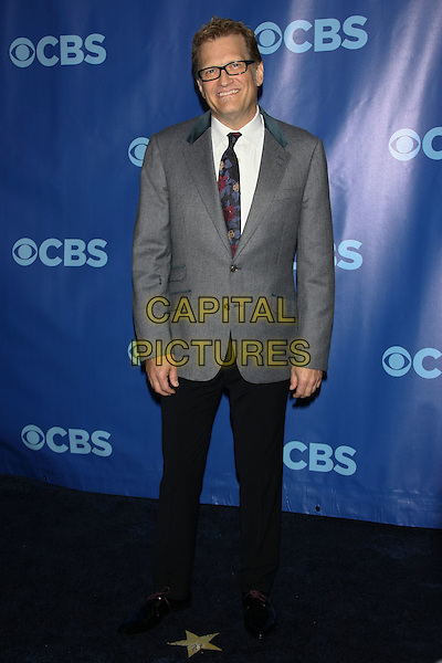 DREW CAREY.The 2011 CBS Upfront (programming presentation to advertisers) held at Damrosch Park - Lincoln Center, New York, NY, US..May 18th, 2011           .full length grey gray suit jacket black trousers glasses .CAP/LNC/TOM.©LNC/Capital Pictures.