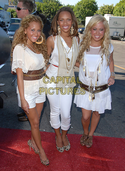 THE CHEETAH GIRLS.At The 2006 Teen Choice Awards - Arrivals, .held at The Universal Ampitheatre in Universal City, California, USA, August 20th 2006..full length white dress top shorts leopard print shoes brown belts.Ref: DVS.www.capitalpictures.com.sales@capitalpictures.com.©Debbie VanStory/Capital Pictures