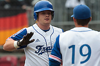 27 july 2010: David Gauthier of France is congratulated by a teammate during France 8-2 victory over Belgium, in day 5 of the 2010 European Championship Seniors, in Stuttgart, Germany.