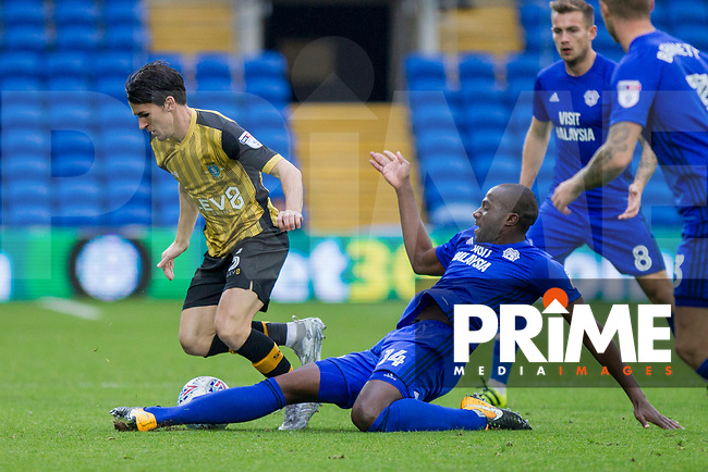 Kieran Lee of Sheffield Wednesday is tackled by Sol Bamba of Cardiff City during the Sky Bet Championship match between Cardiff City and Sheffield Wednesday at Cardiff City Stadium, Cardiff, Wales on 16 September 2017. Photo by Mark  Hawkins / PRiME Media Images.