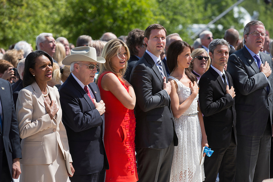Family and former administration members sing God Bless America at the dedication of the George W. Bush presidential library on the campus of Southern Methodist University in Dallas.   From the left are  former U.S. Secretary of State Condoleezza Rice, former Vice President Dick Cheney, Jenna Bush Hager, Henry Hager Barbara Bush,  Miky Fabrega and Jeb Bush