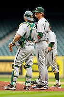 Catcher Joey Hainsfurther #1 of the Baylor Bears has a chat with starting pitcher Logan Verrett #4 during the game against the Houston Cougars at Minute Maid Park on March 4, 2011 in Houston, Texas.  Photo by Brian Westerholt / Four Seam Images