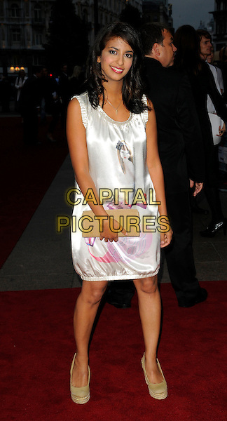 "KONNIE HUQ.World Premiere of ""How to Lose Friends and Alienate People"" at the Empire, Leicester Square, London, England..September 24th 2008.full length white dress clutch bag shoes beige sleeveless silk satin pink print .CAP/CAN.©Can Nguyen/Capital Pictures."