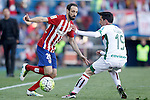Atletico de Madrid's Juanfran Torres (l) and Granada Club de Futbol's Isaac Cuenca during La Liga match. April 17,2016. (ALTERPHOTOS/Acero)