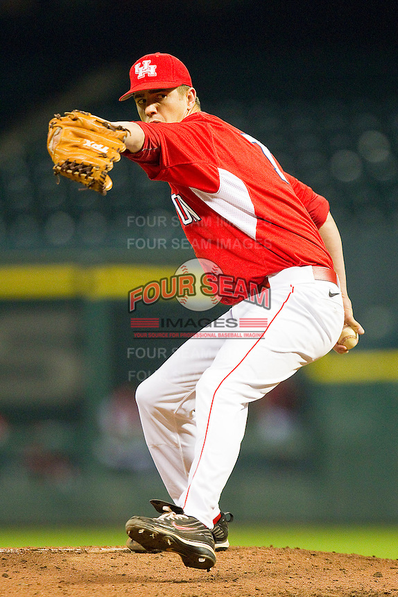 Relief pitcher Chase Dempsay #7 of the Houston Cougars in action against the Texas A&M Aggies at Minute Maid Park on March 6, 2011 in Houston, Texas.  Photo by Brian Westerholt / Four Seam Images