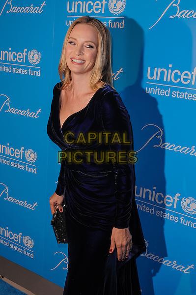 Uma Thurman.Eighth Annual UNICEF Snowflake Ball.', New York, New York, USA..November 27th, 2012.half length black purple blue indigo velvet dress long sleeves smiling.CAP/ADM/MSA.©Mario Santoro/AdMedia/Capital Pictures.