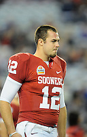 Jan. 1, 2011; Glendale, AZ, USA; Oklahoma Sooners quarterback (12) Landry Jones against the Connecticut Huskies in the 2011 Fiesta Bowl at University of Phoenix Stadium. The Sooners defeated the Huskies 48-20. Mandatory Credit: Mark J. Rebilas-.