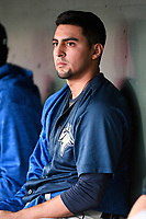 Starting pitcher Marcel Renteria (24) of the Columbia Fireflies waits in the dugout between innings of a game against the Greenville Drive on Tuesday, April 17, 2018, at Fluor Field at the West End in Greenville, South Carolina. He struck out seven batters in 5.1 innings. (Tom Priddy/Four Seam Images)