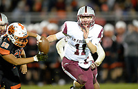La Follette quarterback, Ben Probst, escapes Verona's Henry Tang, as Madison La Follette takes on Verona in Wisconsin Big Eight Conference high school football on Friday, 10/4/19 at Verona High School's Curtis Jones Field