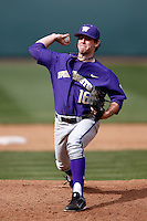Tyler Kane #16 of the Washington Huskies pitches against the UCLA Bruins at Jackie Robinson Stadium on March 17, 2013 in Los Angeles, California. (Larry Goren/Four Seam Images)