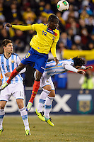 Ecuador midfielder Enner Valencia (13) goes up for a header with Argentina midfielder Ever Banega (19). Argentina and Ecuador played to a 0-0 tie during an international friendly at MetLife Stadium in East Rutherford, NJ, on November 15, 2013.