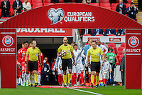 The teams are led out onto the pitch by the match officials during the FIFA World Cup qualifying match between England and Malta at Wembley Stadium, London, England on 8 October 2016. Photo by David Horn / PRiME Media Images.