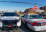 North Bellmore; New York; USA. March 14; 2018. Nassau County Police cars are parked in front of Mepham High School for security if needed, as students, protesting gun violence, walk out of class for 17 minutes; one minute for each student shot and killed last month in a Parkland, Florida, H.S. Students are seen in distance between the patrol cars. It was part of a nationwide walkout in soildarity with student shooting victims, and a demand for U.S. laws to reduce gun violence.