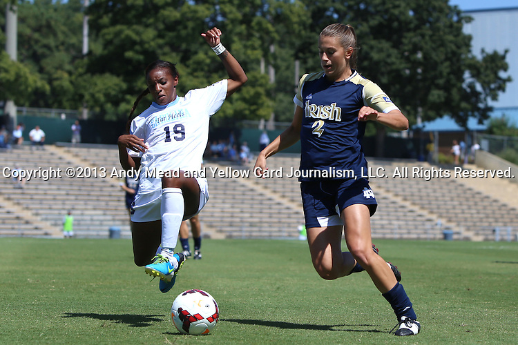 15 September 2013: Notre Dame's Mandy Laddish (2) and North Carolina's Crystal Dunn (19). The University of North Carolina Tar Heels hosted the University of Notre Dame Fighting Irish at Fetzer Field in Chapel Hill, NC in a 2013 NCAA Division I Women's Soccer match. Notre Dame won the game 1-0.