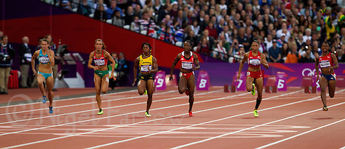 04 AUG 2012 - LONDON, GBR - Competitors race for the finish line during the second women's 100m semi final at the London 2012 Olympic Games athletics at the Olympic Stadium in the Olympic Park, Stratford, London, Great Britain. Pictured left to right are :  Olga Bludova (KAZ), Ivet Lalova (BUL), Shelly-Ann Fraser-Pryce (JAM), Kelly-Ann Baptiste (TRI), Allyson Felix (USA) and Ezinne Okparaebo (NOR) (PHOTO (C) 2012 NIGEL FARROW)