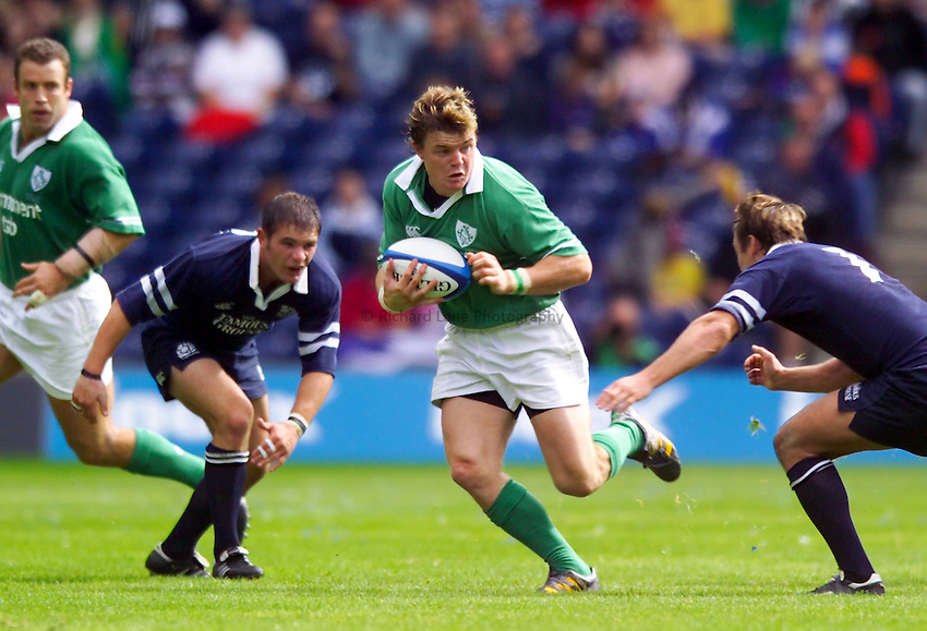 Photo. Jed Wee..Scotland v Ireland, World Cup Warm Up, Murrayfield, Edinburgh. 06/09/2003..Ireland's Brian O'Driscoll (C) with Scotland's Gordon Ross (L).
