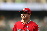 OAKLAND, CA - SEPTEMBER 4:  Mike Trout #27 of the Los Angeles Angels of Anaheim smiles as he walks off the field against the Oakland Athletics during the game at the Oakland Coliseum on Monday, September 4, 2017 in Oakland, California. (Photo by Brad Mangin)