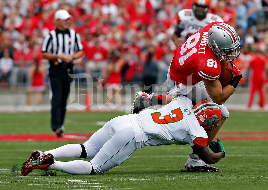 Ohio State Buckeyes tight end Nick Vannett (81) is tackled by Florida A&M Rattlers defensive back Devan Roberts (3) in the first half of their NCAA football game at Ohio Stadium in Columbus, Ohio on September 21, 2013. (Columbus Dispatch photo by Brooke LaValley)