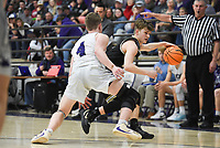 Charleston guard Brandon Scott (12) drives the ball past Elkins Caden Vaught (4), Friday, February 14, 2020 during a basketball game at Elkins High School in Elkins. Check out nwaonline.com/prepbball/ for today's photo gallery.<br /> (NWA Democrat-Gazette/Charlie Kaijo)