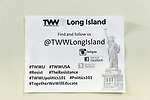 Wyandanch, New York, USA. March 26, 2017. Flier for TWW Long Island is posted on meeting place wall for Politics 101 event, the first in a series of activist training workshops for members of Long Island affiliate of national Together We Will. Flier includes social media info, including @TWWLongIsland - which is the Instagram, Facebook and twitter handle for group - plus related hashtags: #TWWLI  #TWWUSA #Resist #TheResistance #Politics101 and more. Elected officials and community leaders spoke and answered questions.