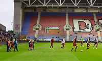 Young Liverpool supporters run onto the pitch as the players warm up in the HT break during the pre season friendly match between Wigan Athletic and Liverpool at the DW Stadium, Wigan, England on 14 July 2017. Photo by Andy Rowland.
