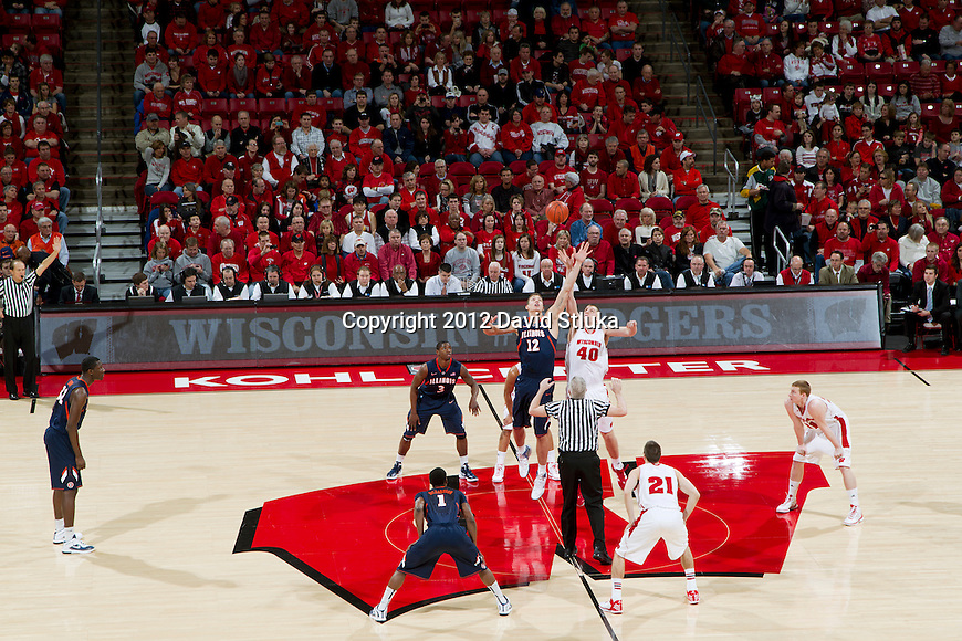 The opening tip-off of the Wisconsin Badgers Big Ten Conference NCAA college basketball game against the Illinois Fighting Illini on Sunday, March 4, 2012 in Madison, Wisconsin. The Badgers won 70-56. (Photo by David Stluka)