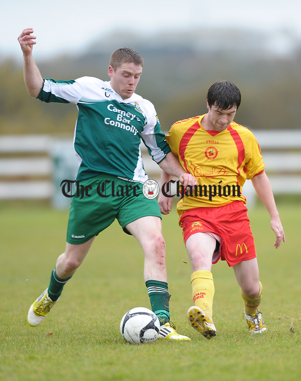 Brian Connellan of Connolly Celtic in action against Mattie Nugent of Avenue United during their Premier League Cup Final at The County Grounds,  Doora. Photograph by John Kelly.