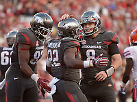 NWA Democrat-Gazette/BEN GOFF @NWABENGOFF<br /> Jeremy Sprinkle (83), Arkansas tight end, and Austin Allen (8), Arkansas quarterback, congratulate Rawleigh Williams III after he ran in a touchdown against Florida in the 4th quarter on Saturday Nov. 5, 2016 during the game in Razorback Stadium in Fayetteville.