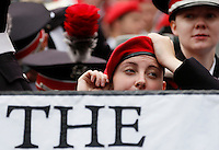 A member of the Ohio State University Marching Band straightens her beret before Saturday's NCAA Division I football game between the Ohio State Buckeyes and the Navy Midshipmen at M&T Bank Stadium in Baltimore on August 30, 2014. (Dispatch Photo by Barbara J. Perenic)