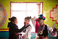 East Village, Diqing Tibetan Autonomous Prefecture, Yunnan Province, China - Tibetan girls prepare to perform traditional Xianzi Dance, February 2017.