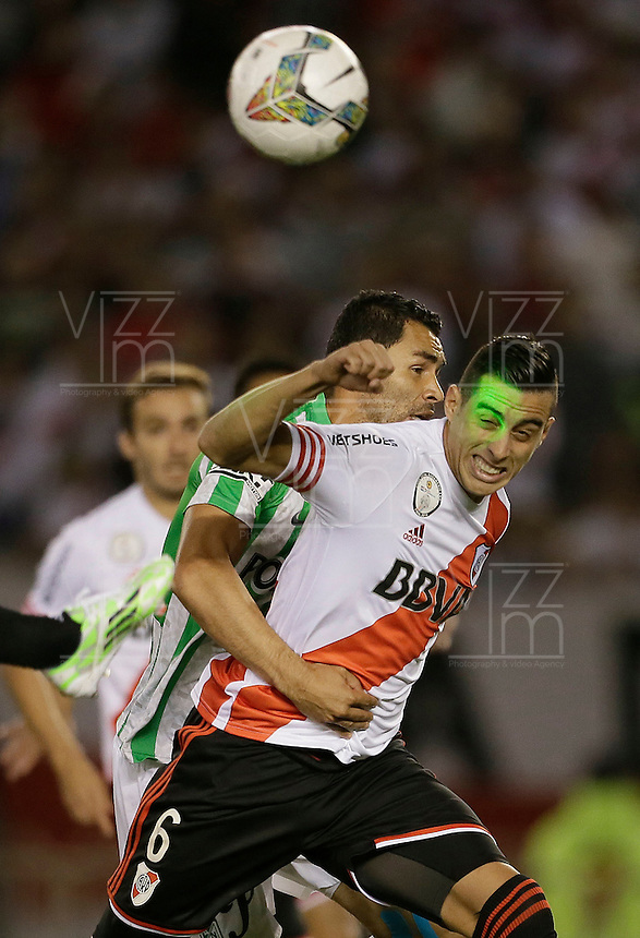 BUENOS AIRES - ARGENTINA - 10-12-2014: Ramiro Funes Mori (Der.) jugador de River Plate de Argentina disputa el balon con Alejandro Bernal (Izq.) jugador de Atletico Nacional de Colombia durante partido de vuelta de la final, de la Copa Total Suramericana entre River Plate de Argentina y Atletico Nacional de Colombia en el Estadio Antonio Vespucio Liberti- Monumental de Nuñez, de la ciudad de Buenos Aires.  Ramiro Funes Mori (R) player of River Plate of Argentina vies for the ball with con Alejandro Bernal (L) player Atletico Nacional of Colombia during a match for the second leg of the final, between River Plate of Argentina and Atletico Nacional for the Copa Total Suramericana in the Antonio Vespucio Liberti- Monumental de Nuñez, Stadium, in Buenos Aires city. Photo:  Photogamma / VizzorImage.