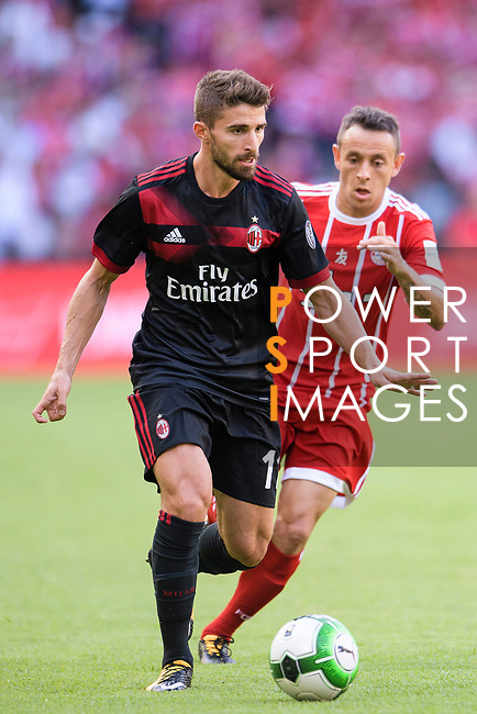 AC Milan Forward Fabio Borini (L) in action during the 2017 International Champions Cup China match between FC Bayern and AC Milan at Universiade Sports Centre Stadium on July 22, 2017 in Shenzhen, China. Photo by Marcio Rodrigo Machado/Power Sport Images