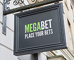 Close up of wall mounted Megabet betting shop sign, 'Place your Bets', Devizes, Wiltshire, England, UK