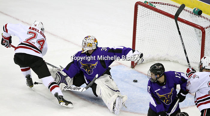University of Nebraska Omaha's Bryce Aneloski slips the puck past Minnesota State University-Mankato goalie Phil Cook to put UNO up 1-0 in the first period. (Photo by Michelle Bishop)