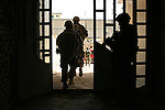 U.S. soldiers from Company C, 2nd Battalion, 327th Infantry Regiment leave an apartment building in Samarra, Iraq where they questioned residents about a string of bomb attacks have taken place against them in recent weeks. Nov. 17, 2007. DREW BROWN/STARS AND STRIPES